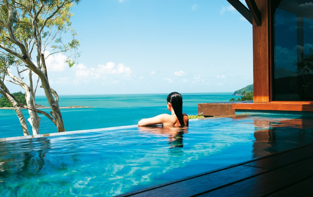 Windward-Pavilion-qualia-woman-in-plunge-pool_cmyk